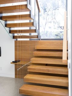 Feature Stair | Floating Stair | Cantilevered | Steel Stringers | Architecture | Design | Interior | Concrete Floor | Feature Ceiling | Glass Balustrade | Handrail | Timber | Light | S&A Stairs | Melbourne | Australia