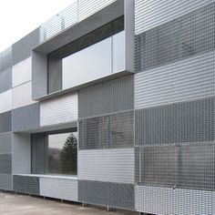 Mix of metal grates with thin, projected window mullion. Stein Van Rossem