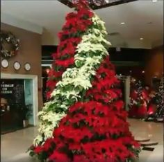 Try some of the unique Christmas tree decor ideas from our gallery to have a Christmas tree like never before. Church Christmas Decorations, Unique Christmas Trees, Holiday Tree, Xmas Tree, Beautiful Christmas, Commercial Christmas Decorations, Poinsettia Tree, Christmas Poinsettia, Christmas Flowers