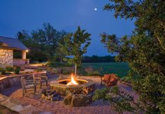 Must have an outdoor entertaining area! Liking this fire pit and native landscaping.