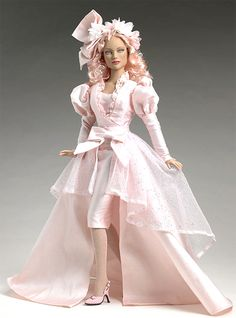 """From the Tonner Wizard of Oz Collection, the lovely Good Witch Glinda in """"Ambassador in Pink"""". Extraordinary two-piece shantung pink floor length gown. """"Ambassador in Pink"""". Pretty Dolls, Beautiful Dolls, Pink Hair, Blue Hair, Wizard Of Oz Dolls, Pink Doll, Pink Cotton Candy, Pink Gowns, Barbie World"""