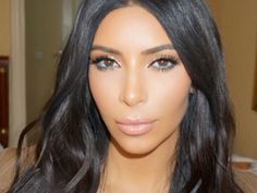 Kim experiments with turquoise eyeliner in Armenia