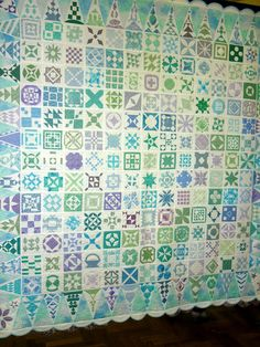 Close-up, aqua, green and lavender Dear Jane quilt, 2013 Australian Quilters Association show, photo by Linda Bear at Pin Money Quilts