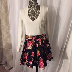 Long sleeve floral dress Long sleep dress white top and the bottom is floral. Dresses Mini