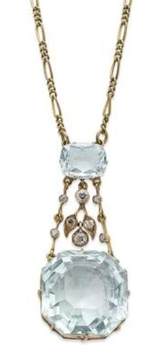 *An Edwardian aquamarine and diamond pendant Formed as a cushion-cut aquamarine suspending a pair of articulated-diamond-set knife-edge bars and a diamond-set foliate drop, terminating in a square octagonal-cut aquamarine, all to a later fancy-link chain.