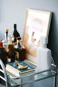 Vintage bar cart + white ceramic flask - styling by Black Lacquer Design. It's all in the detail.