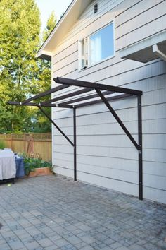 How is a super cheap pergola built?, How is a super cheap pergola built? # economic # buildings When historic with principle, this pergola has been encountering somewhat of a present day renaissance these types of days. Diy Pergola, Pergola Cost, Outdoor Pergola, Backyard Patio, Backyard Landscaping, Outdoor Decor, Cheap Pergola, Small Pergola, Modern Pergola