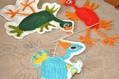 Materials: Marius, cotton yarn, foam rubber    Description: I have crocheted a free form motif with birds. The pattern to the birds can be downloaded free at the knit and crochet site ravelry.com.
