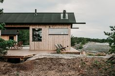 〚 Modern wooden cabin with sauna on rocky island in Finland 〛 ◾ Photos ◾Ideas◾ Design Ideas De Cabina, Summer Cabins, Solar, Wooden Cabins, Wood Siding, Cabin Homes, Tiny Homes, Nordic Design, Large Windows