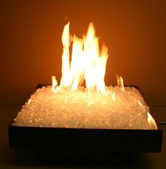 White Fire Glass | Fire glass is tempered glass manufactured in pebble-sized fragments used as a medium to retain and direct heat, usually in gas fireplaces and fire pits. Fire glass does not burn, but retains heat and refracts light as a result of burning gas. Fire glass produces more heat than real wood and also is environmentally friendly. There is no smoke, it's odorless and doesn't produce ash. It comes in many colors.