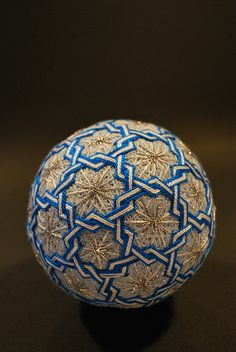 Temari ball 'May2009_412' photographed by Nana Akua & created by her 88 year old grandmother. Since the 1960s the grandmother has made hundreds of them, & her granddaughter, Nana Akua, has documented them on her flickr site. via flickr