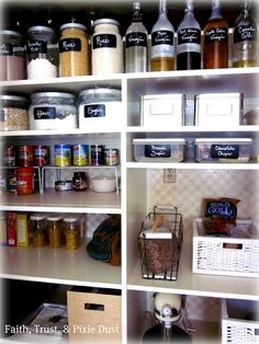 I like the use of the glass bottles and jars to get away from the grocery shelf look. The uniformity of the chalkboard labels pulls it together.