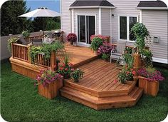deck designs with flower boxes deck design creates an eating area and a sitting area - Home Deck Design