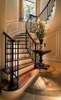 Understated elegant staircase design with lovely railing, balustrades, limestone/marble/travertine flooring. P&H Interiors.