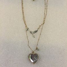 Betsey Johnson fly with me necklace Selling some of my Betsey to buy pieces I'm missing. Authentic Betsey necklace. Has a cute mirror heart that says fly with me, has a bird in the center and tiny rhinestone . Betsey Johnson Jewelry Necklaces