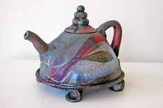 "Barbara Guidage took first place in the contemporary category of the ""Raku Ho'olaulea 2006 Juried Exhibition, with ""Tea Waves."""