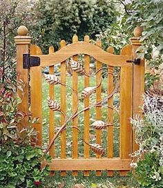 Attractive Wooden Garden Gate With Metal Leaf Design