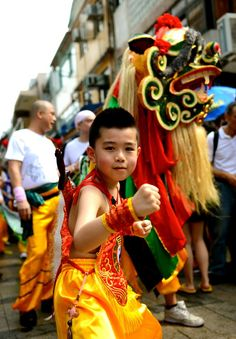 HAPPY NEW YEAR!!....................Youngster celebrating HongKong's iconic Cheung Chau Bun Festival, 2013