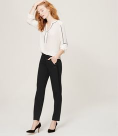 "Flaunting satiny tuxedo stripes, our skinny ankle pants are mid-rise and slim throughout with a narrow leg and slight crop. Your perfect fit if your hips are proportionate to your waist. Front zip with hook and bar closure. Slash pockets. Back welt pockets. Satiny waistband, pockets and tuxedo stripes down legs. 28"" inseam."