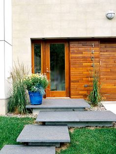 like the modern front steps and the use of cedar- great for my Belleau Bend house
