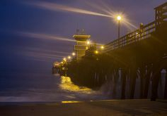 High king tide carries on during dusk at Seal Bach Pier California. Sea Photography, Photography For Sale, Landscape Photography, Seal Beach, Sale Poster, Long Exposure, American Artists, Artist At Work, Beautiful Landscapes