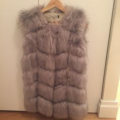 Grey Faux Fur Long Gilet Vest Jacket Medium Gorgeous faux fur paneled gilet longline jacket. Patterned inside worn once. Labeled as a size Large but I would say this is a medium Jackets & Coats Vests