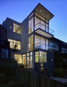 Great Three Level Modern White Home With Balcony And Glazed Wall Exterior