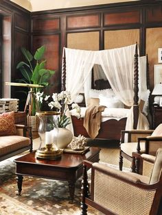 Be sure to include large potted plants such as ferns and palms, as well as orchids, in your design. Add uplights beneath them for more drama. (Eye For Design: Tropical British Colonial Interiors)