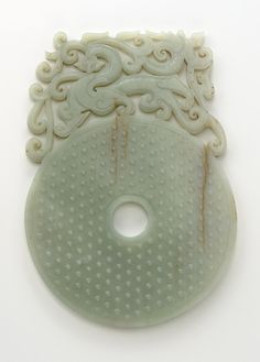 Disk (bi) with knobs, feline and dragon 100-220 Eastern Han dynasty Jade (nephrite) W: 2.5 cm China