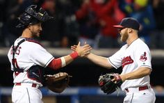 Cleveland Indians relief pitcher Cody Allen, right, and catcher Yan Gomes celebrate the team's 7-6 win over the Boston Red Sox in a baseball game, Wednesday, April 6 in Cleveland.
