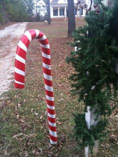Don't throw away those old pool noddles! Pool noodles make great Christmas decorations when they get a special touch like this candy cane created by friend and neighbor Stephanie Dyer! Stephanie covered the pool noodle in white duct tape, then went back with red for the candy cane effect. The curve was made and held …
