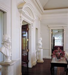 Busts of Thomas Jefferson and George Washington, my patron saints, watch over the classical architecture of the Great hall with is 24-foot high tray ceiling. A profusion of bougainvillea on the grounds make flower arranging easy. Photo Credit: John M. Hall Photography