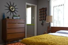 Paint colors that match this Apartment Therapy photo: SW 7025 Backdrop, SW 6048 Terra Brun, SW 6396 Different Gold, SW 7675 Sealskin, SW 7757 High Reflective White