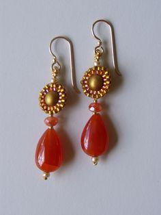 Circle earrings with carnelian drops by Jeka Lambert.  Seed bead woven.  Glass beads, carnelian drop beads, seed beads.
