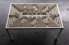 "The playful ""Labyrinth Table"" has a giant maze with moveable figures inside."