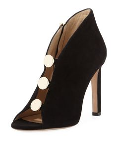 """Jimmy Choo suede bootie with front logo studs. 4"""" covered stiletto heel. Open toe. Slit front. Side zip eases dress. Leather outsole. """"Lorna"""" is made in Italy."""