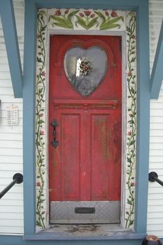 Red door with patterned trim. More