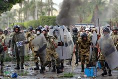 Security forces throw stones back at protesters near Egypt's Defence Ministry May 4, 2012. REUTERS /Asmaa Waguih