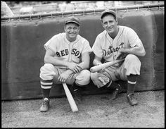 Boston Red Sox Jimmie Foxx and Detroit Tiger Hank Greenberg crouching in front of the screen at Fenway Park 1937.