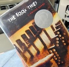 The Book Thief by Markus Zusak  During WWII, a young girl named Liesel finds solace by stealing books and sharing them with others. Under the stairs in her home, a Jewish refuge is being sheltered by her adoptive parents. The book is narrated by Death, so it will be interesting to see how this translates to film.