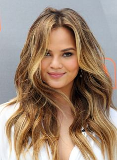 Chrissy Teigen Gosh I'm a woman,but I have a crush on her lol. She is absolutely gorgeous,her hair are amazing and her style is just perfect!!! She is a truly beauty a great mix of Asian and european genes..good match