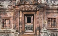 Banteay Srei, One of the smallest but most perfect of all Angkor's temples, constructed from delicate rose-pink sandstone and covered in a positive riot of intricate carvings. #travel #cambodia #temple
