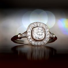 71f5da008d4 Antique Diamond Halo Engagement Ring with .60 Old Mine Cushion Cut Diamond  - Circa 1925. Cette bague ...