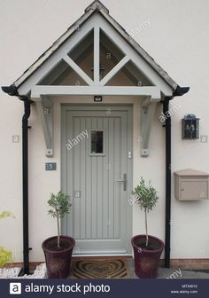 Stock Photo - Front door, storm porch and two small olive trees with letterbox and outside light Exterior Door Styles, Small Exterior Doors, Porch Design, Exterior Front Doors, Cottage Style Front Doors, Cottage Front Doors, Front Door Porch, Porch Canopy, Wooden Porch