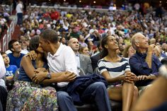 """Obama kisses the First Lady for the """"Kiss Cam"""" at the U. Men's Olympic basketball team's game against Brazil July Vice President Joe Biden and Malia Obama look up at the jumbotron. (Official White House Photo by Pete Souza) Malia Obama, Barack Obama Family, Michelle Obama, Joe Biden, Kiss Cam, Big Kiss, Obama Photos, Presidente Obama, Black Presidents"""