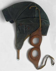 Leather motorist cap with visor and protective ear band & protective eye glasses (transparent), circa 1920, Portugal - National Museum of Costume.