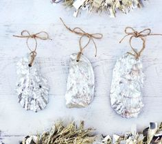 Recycled Oyster Shell Ornaments Painted Silver... http://www.completely-coastal.com/2016/11/handmade-coastal-beach-nautical-ornaments.html