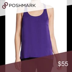 "BCBGMAXAZRIA Purple Top BCBGMAXAZRIA racerback style top with a hi-lo hem scoopneck. Sleeveless with silky texture and feel. Side slits at hem. Pullover style. About 29"" from shoulder to hem, bust: 36""-38"". Polyester.Machine wash or dry clean. New with tag. BCBGMaxAzria Tops Blouses"