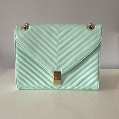 """$3.99 SHIPPING Chic Shoulder & Crossbody Purse Make an outfit pop with this bright mint green bag. Great condition, gold shoulder strap that converts to a Crossbody strap as well. Has striped lining, zipper n two side pockets. Gold hardware, magnetic button closure. Has one mark hidden on the handle as seen in photo. 11.5"""" L x 2.5"""" W x 9"""" H JustFab Bags Crossbody Bags"""