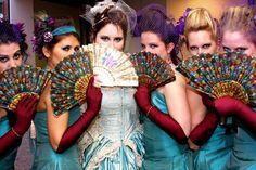 Purple-veiled, turquoise-bedecked bridesmaids.